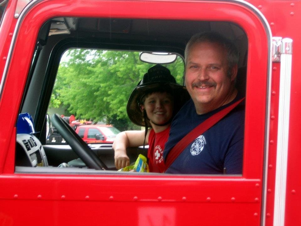 Photo - This image provided by Gallitan County Fire Department shows Chief Todd Rummel, who was killed in an accident June 19, 2014, after a fire engine and a pickup truck collided on a Montana highway, causing an explosion and fire that killed a family of five and Rummel. Passenger is unidentified. (AP Photo/Gallitan County Fire Department)
