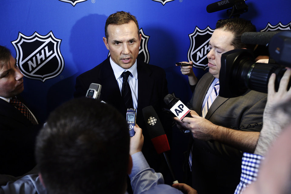 Tampa Bay Lightning general manager Steve Yzerman speaks to reporters, Wednesday, Jan. 9, 2013, in New York. NHL owners ratified the tentative labor deal on Wednesday. All that now remains is player approval to finally start the hockey season. (AP Photo/Frank Franklin II)