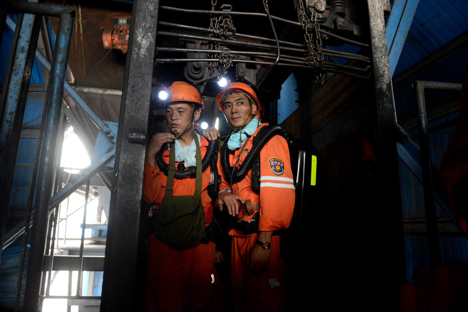 Photo - In this Aug. 19, 2014 photo, rescuers prepare to go into the Dongfang Coal Mine in Huainan city, east China's Anhui Province.  An explosion Tuesday in the coal mine in eastern China trapped 27 workers underground, state media reported. (AP Photo/Xinhua, Zhang Duan) NO SALES