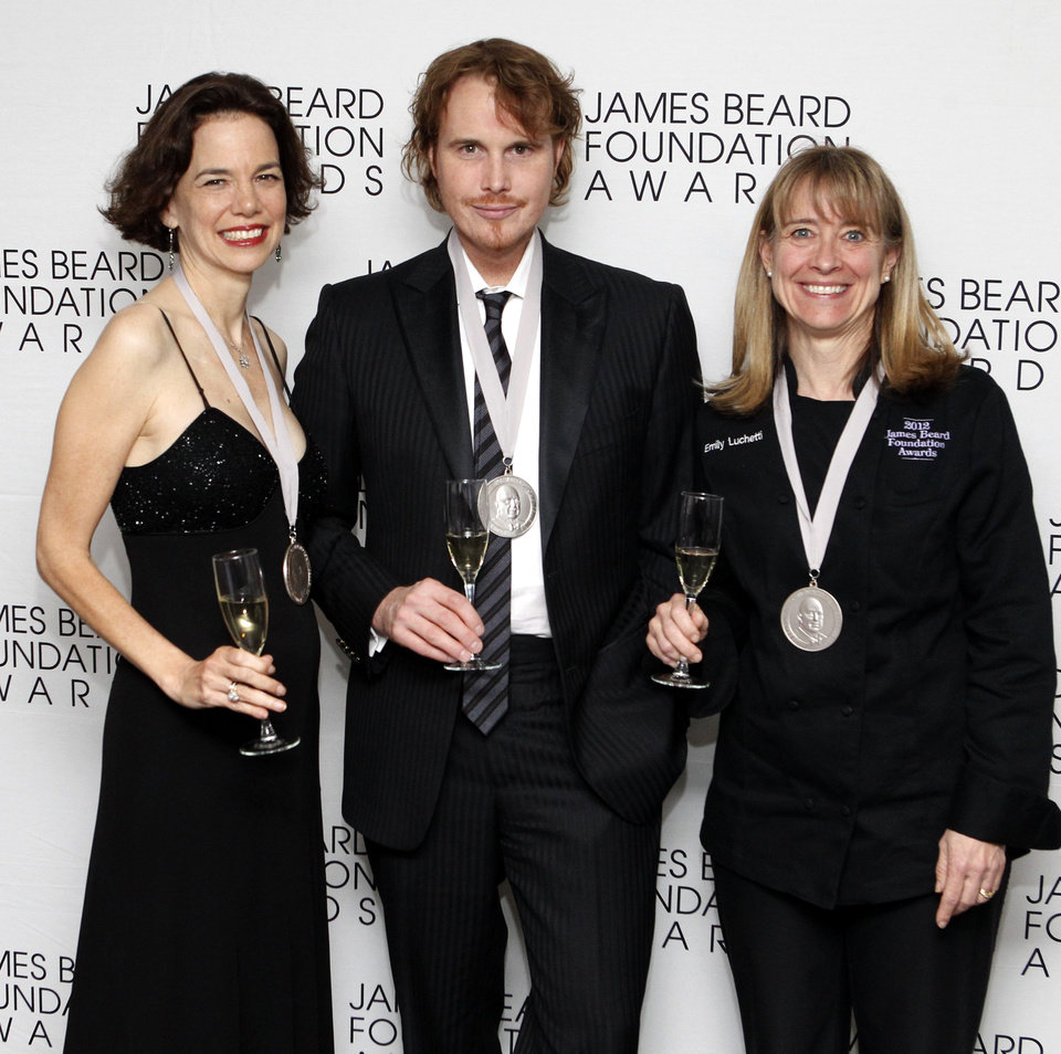 Photo -   From left, journalist Dana Cowan, chef Grant Achatz and chef Emily Luchetti pose together after their Who's Who of Food & Beverage in America induction during the James Beard Foundation Awards, Monday, May 7, 2012, in New York. (AP Photo/Jason DeCrow)