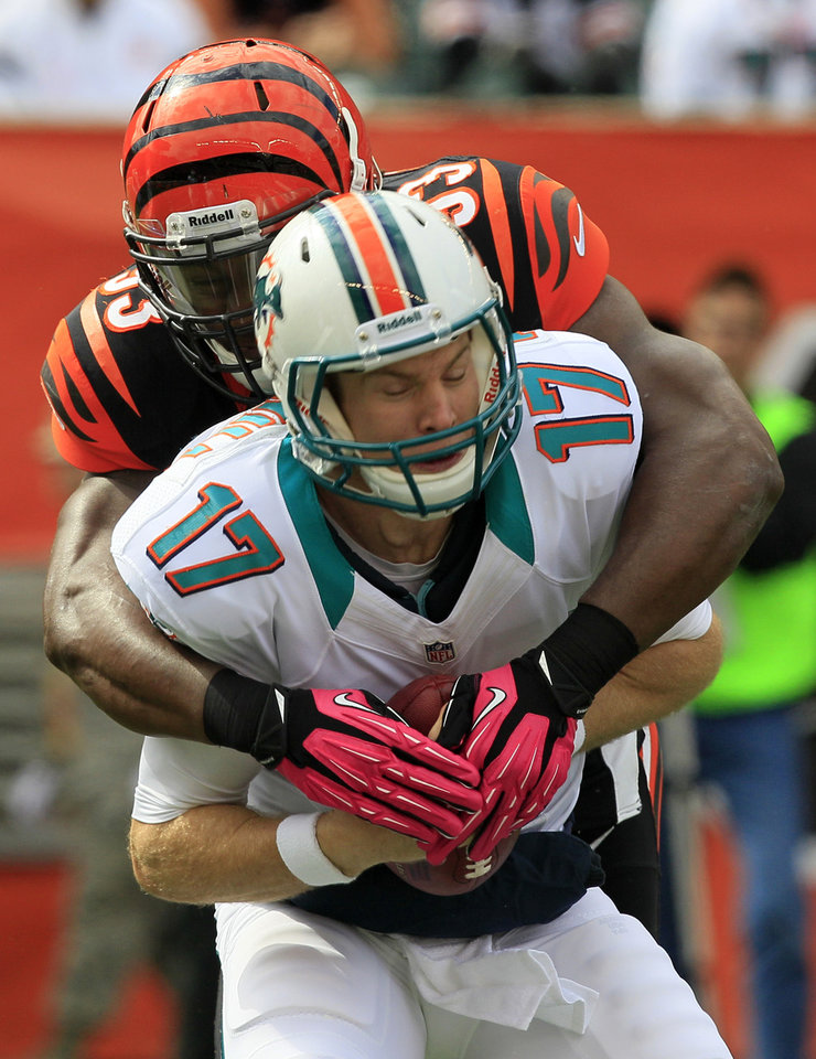 Miami Dolphins quarterback Ryan Tannehill (17) is sacked by Cincinnati Bengals defensive end Michael Johnson (93) in the first half of an NFL football game, Sunday, Oct. 7, 2012, in Cincinnati. (AP Photo/Al Behrman)