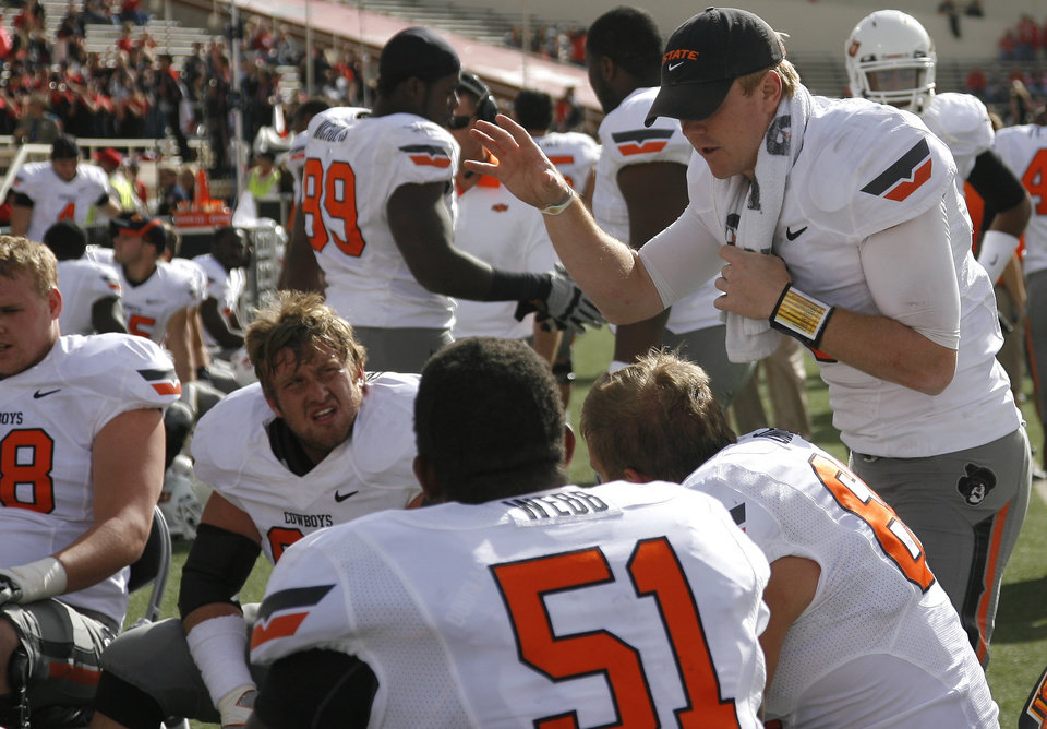 Photo - Oklahoma State's Brandon Weeden (3) talks to teammates during a college football game between Texas Tech University (TTU) and Oklahoma State University (OSU) at Jones AT&T Stadium in Lubbock, Texas, Saturday, Nov. 12, 2011.  Photo by Sarah Phipps, The Oklahoman  ORG XMIT: KOD