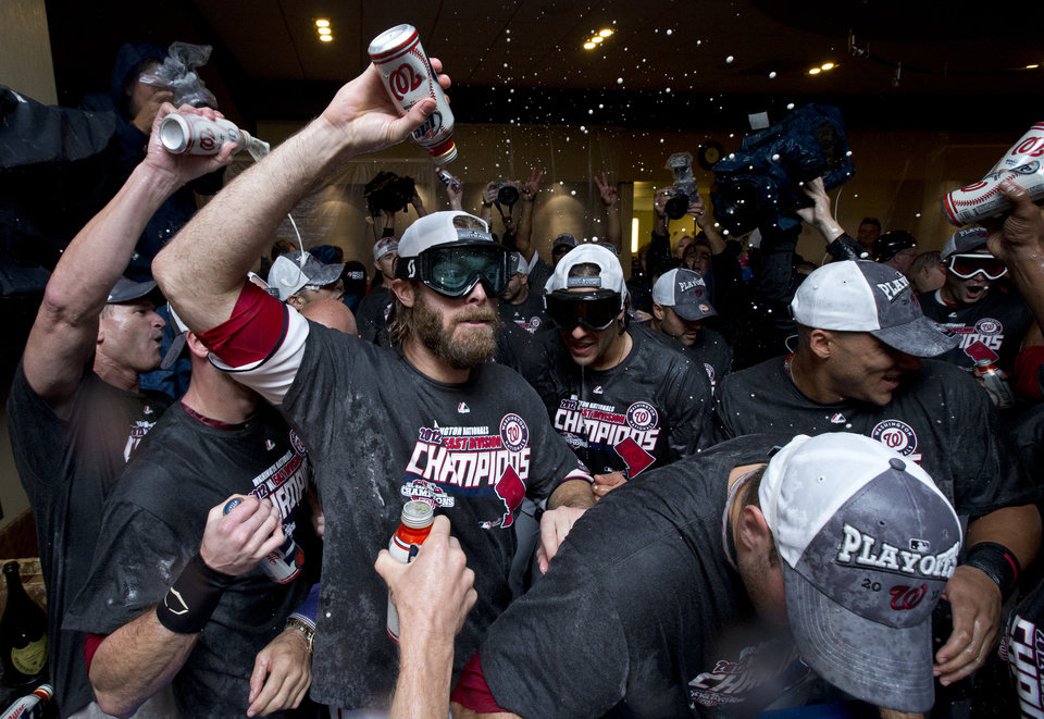 Photo -   Washington Nationals right fielder Jayson Werth, center, celebrates with teammates after clutching the National League East division title following a baseball game against the Philadelphia Phillies in Washington, Monday, Oct. 1, 2012. (AP Photo/Manuel Balce Ceneta)