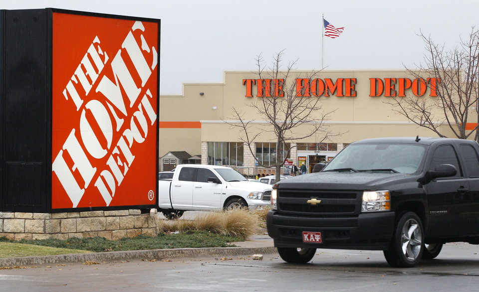 Photo - FILE - In a Nov. 14, 2011, file photo, a truck pulls out of the parking lot at a Home Depot store in Oklahoma City. Home Depot Inc. reports quarterly earnings on Tuesday, May 20, 2014. (AP Photo/Sue Ogrocki, File)