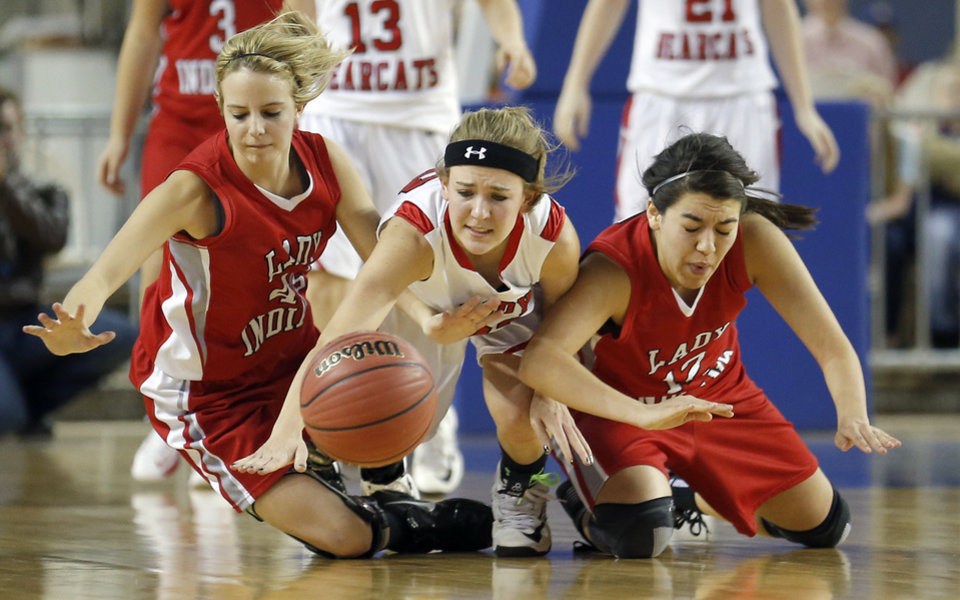 Shattuck's Katelyn Cummings, left,  and Marissa Galindo fight for a loose ball Erick's Makenzie Kelly during the Class B Girls semifinal game of the state high school basketball tournament between Erick and Shattuck  at the State Fair Arena., Friday, March 1, 2013. Photo by Sarah Phipps, The Oklahoman
