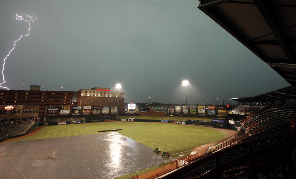 Lightning strikes during a rain delay of the baseball game between Oklahoma City RedHawks and Omaha Royals at the At&T Bricktown Ballpark, Saturday July 4, 2009, in Oklahoma City. Photo by Sarah Phipps, The Oklahoman