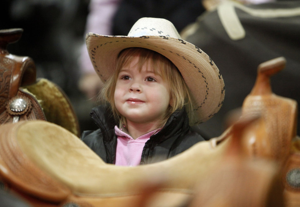 Three-year-old Eva Smallegan, from Michigan, waits while her parents look at saddles during the National Reining Horse Association show at State Fair Park in Oklahoma City, OK, Saturday, November 24, 2012,  By Paul Hellstern, The Oklahoman