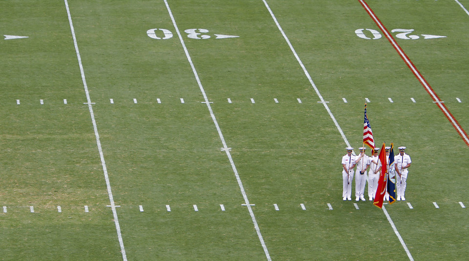 Photo - Members of the Navy flag corp stand on the field during the National Anthem during the Red River Rivalry college football game between the University of Oklahoma Sooners (OU) and the University of Texas Longhorns (UT) at the Cotton Bowl in Dallas, Saturday, Oct. 8, 2011. Photo by Chris Landsberger, The Oklahoman