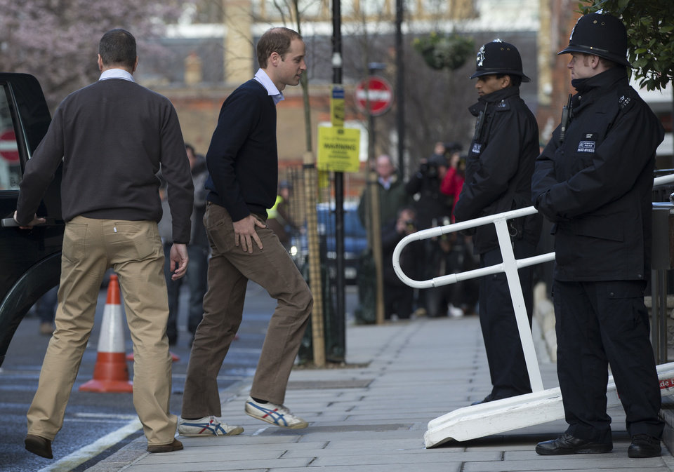 Photo - Britain's Prince William arrives at the King Edward VII hospital to visit his wife the Duchess of Cambridge in central London, Wednesday, Dec. 5, 2012.  Prince William and his wife Kate are expecting their first child, and the Duchess of Cambridge has been admitted to hospital suffering from a severe form of morning sickness in the early stages of her pregnancy. (AP Photo/Alastair Grant)