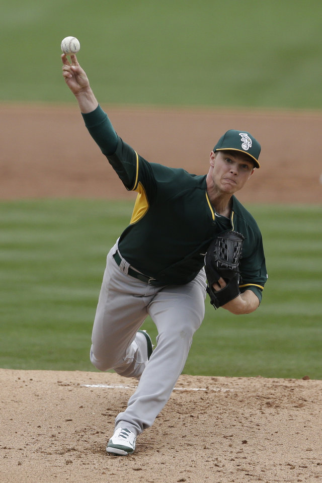 Photo - Oakland Athletics starting pitcher Sonny Gray delivers to an Arizona Diamondbacks batter during the first inning of a spring exhibition baseball game on Thursday, March 6, 2014, in Scottsdale, Ariz. (AP Photo/Gregory Bull)