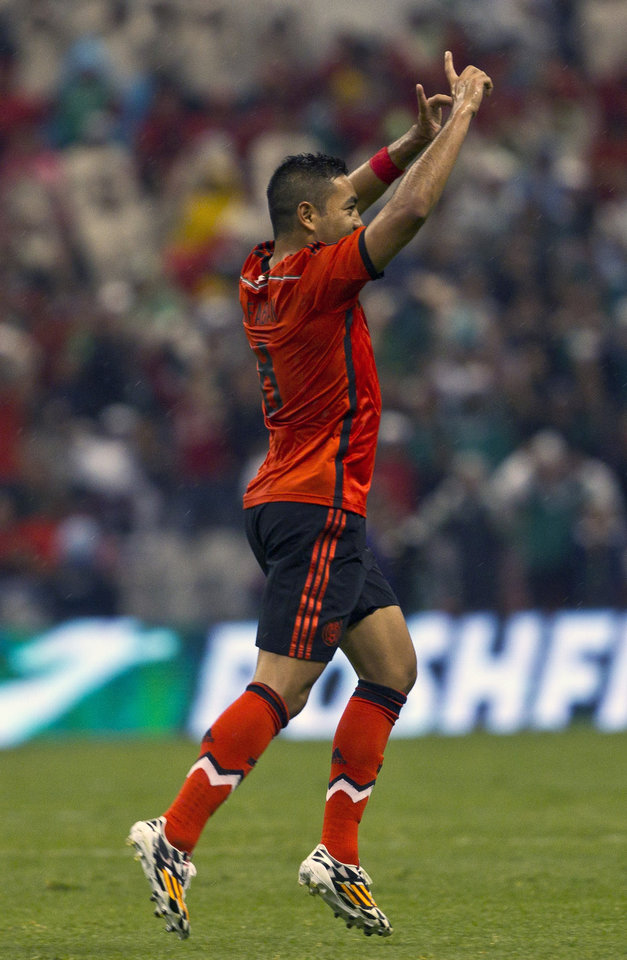 Photo - Mexico's Marco Fabian, celebrates after scoring against Israel during a friendly match in Mexico City, Wednesday, May 28, 2014. (AP Photo/Christian Palma)