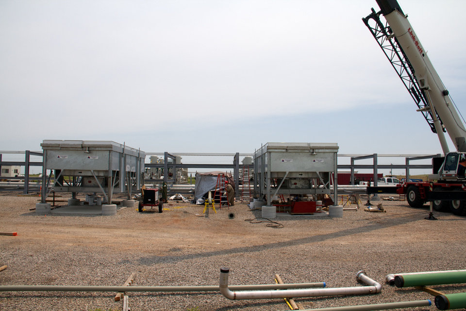 Compressors at Chaparral Energy's North Burbank field in Osage County take carbon dioxide recovered from producing wells, compresses it before it is reinjected into the rock layers underground. Two compressors are operational, but the company plans to expand the facility to 16 units. <strong>photo by Adam Wilmoth</strong>