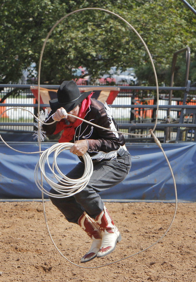 Rich Gratny, with the Wild West Stunt Riders Show, does rope tricks during the Oklahoma State Fair at State Fair Park in Oklahoma City, OK, Thursday, September 20, 2012,  By Paul Hellstern, The Oklahoman