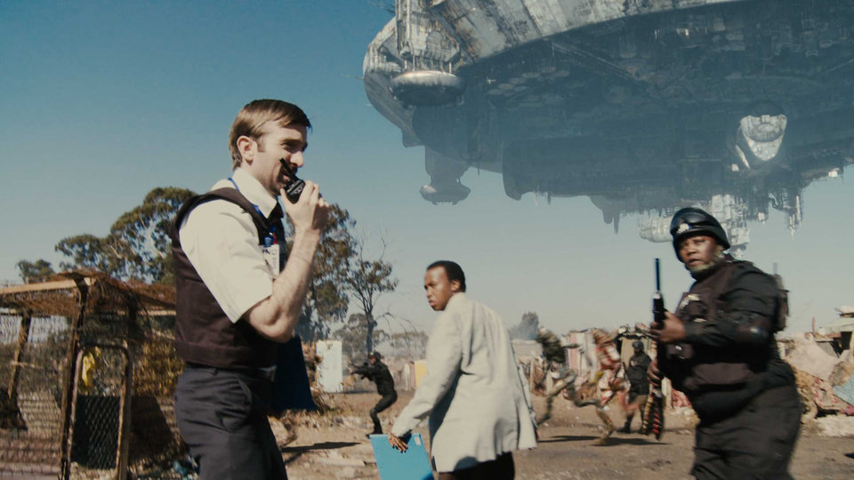 Photo - From left, Sharlto Copley, Mandla Gaduka and Kenneth Nkosi share a scene in the sci-fi thriller