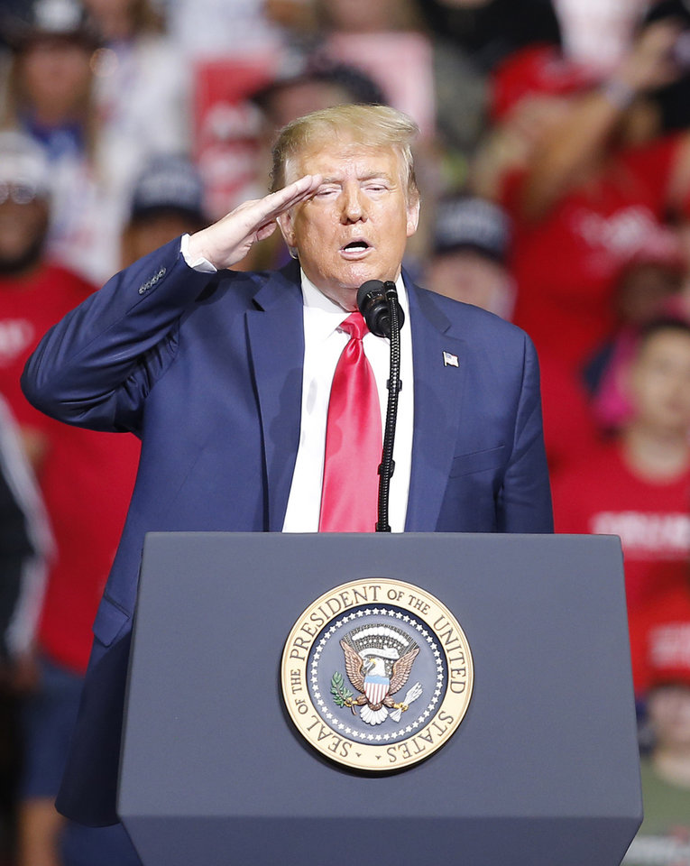Photo - President Donald Trump salutes during a rally at the BOK Center in Tulsa, Okla., Saturday, June 20, 2020. [Sarah Phipps/The Oklahoman]
