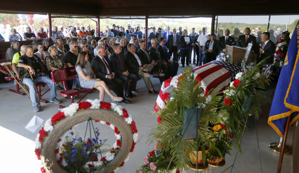 Photo - Inside the pavilion as State Sen. Chuck Hall speaks during the funeral service for World War II veteran Herman White at Grace Hill Cemetery in Perry, Okla., Wednesday, Sept. 4, 2019. Hundreds of people attended Navy Seaman 2nd Class White's funeral after learning that he had no surviving family members to be there. [Nate Billings/The Oklahoman]