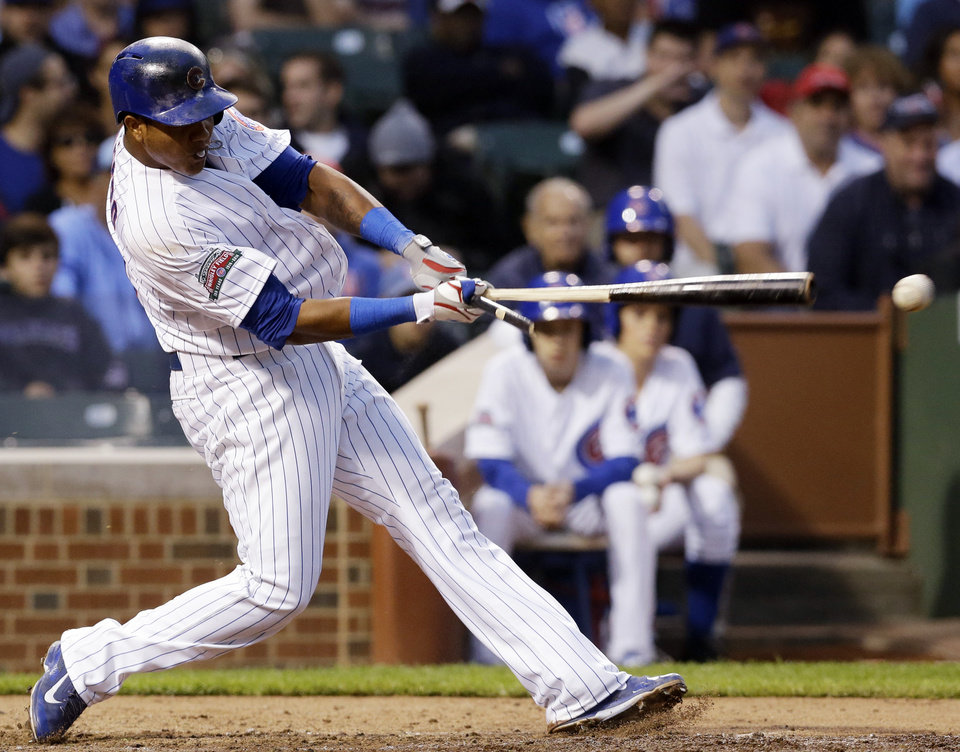 Photo - Chicago Cubs' Starlin Castro hits a two-run single during the fourth inning of a baseball game against the Washington Nationals in Chicago, Thursday, June 26, 2014. (AP Photo/Nam Y. Huh)