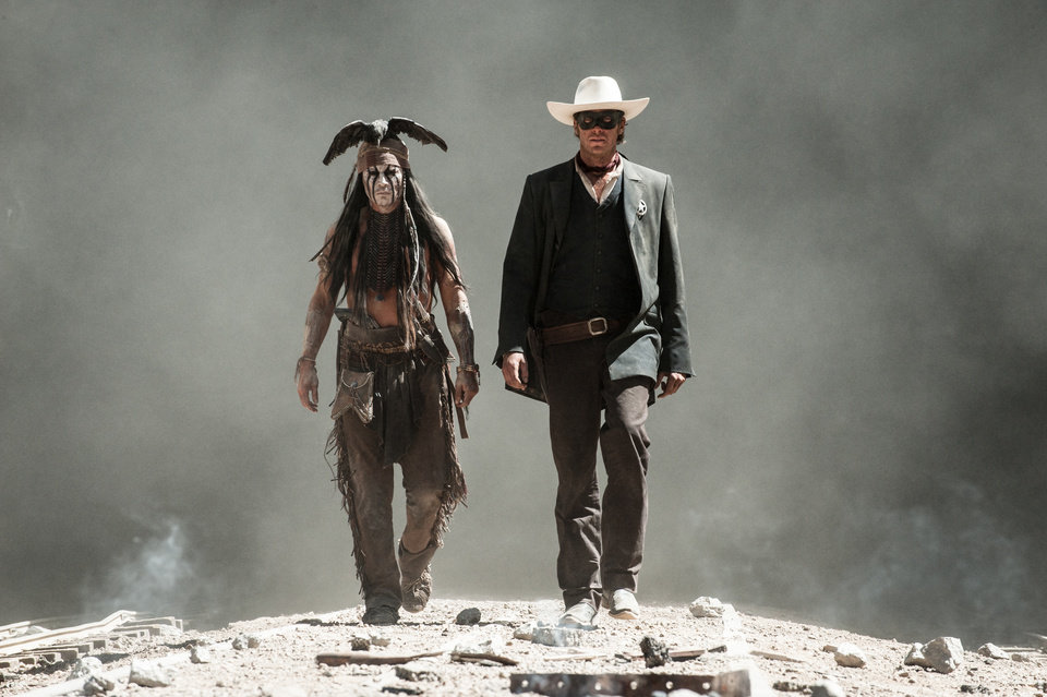 "This publicity image released by Disney shows Johnny Depp as Tonto, left, and Armie Hammer as The Lone Ranger, in a scene from ""The Lone Ranger,"" opening July 3, 2013. (AP Photo/Disney Enterprises, Inc. and Jerry Bruckheimer Inc., Peter Mountain)"