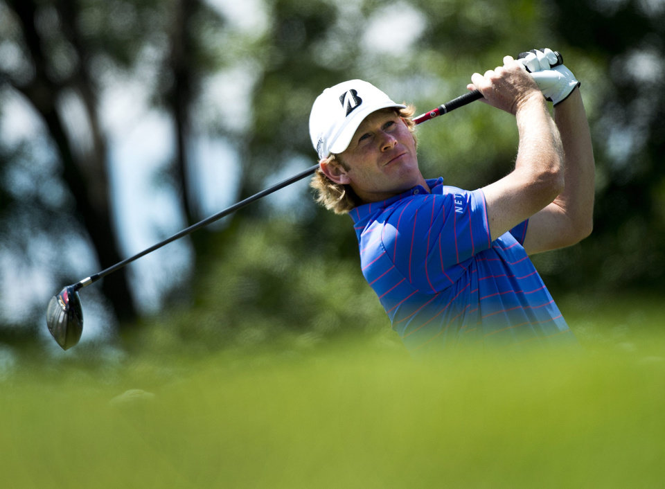 Photo - Brandt Snedeker, of the United States, watches his tee shot on the third hole during the final round of play at Glen Abbey at the Canadian Open golf tournament in Oakville, Ontario, Sunday, July 28, 2013. (AP Photo/The Canadian Press, Nathan Denette)