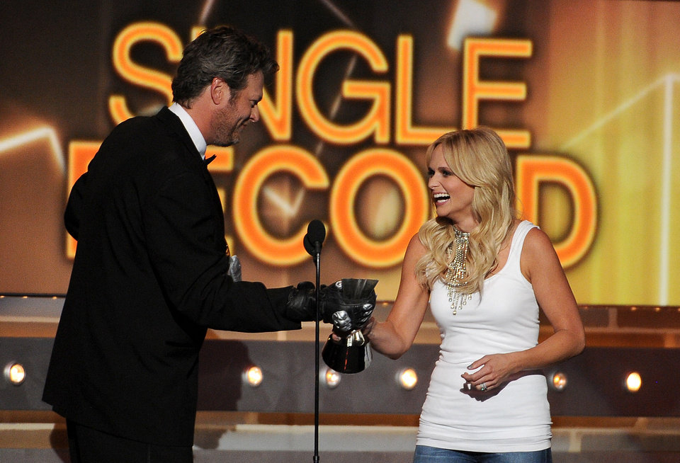 Photo - Host Blake Shelton, left, presents the single record of the year award to Miranda Lambert at the 49th annual Academy of Country Music Awards at the MGM Grand Garden Arena on Sunday, April 6, 2014, in Las Vegas. (Photo by Chris Pizzello/Invision/AP)