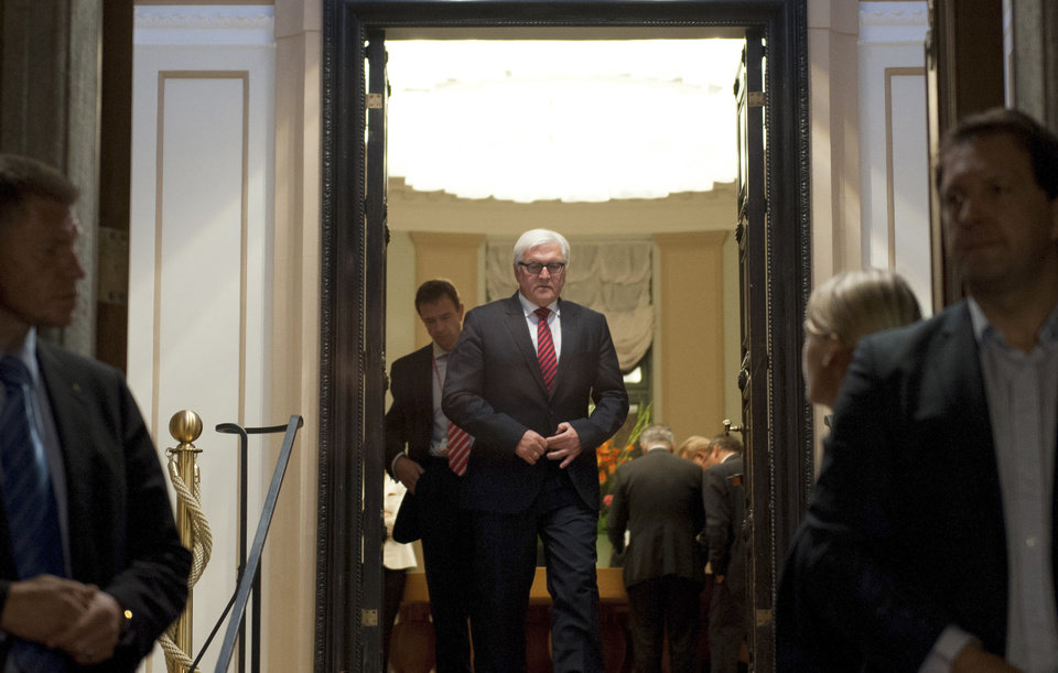 Photo - Foreign Minister of Germany Frank-Walter Steinmeier steps out to brief the media after a meeting with his counterparts from Ukraine, Russia, and France at the Guesthouse of Foreign Ministry Villa Borsig in Berlin, Monday, Aug. 18, 2014. The talks aimed at finding a political solution to the conflict in Ukraine ended without any substantial result.  (AP Photo/Steffi Loos)