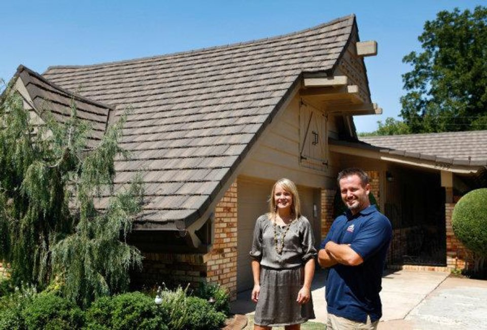 Michelle Foy, a Realtor with Verbode, a real estate agency, and Chris Wright stand at Wright's house at 2329 NW 55, which has some green elements that the revamped Multiple Listing Service acknowledges. Photo by Jim Beckel, The Oklahoman <strong>JIM BECKEL</strong>