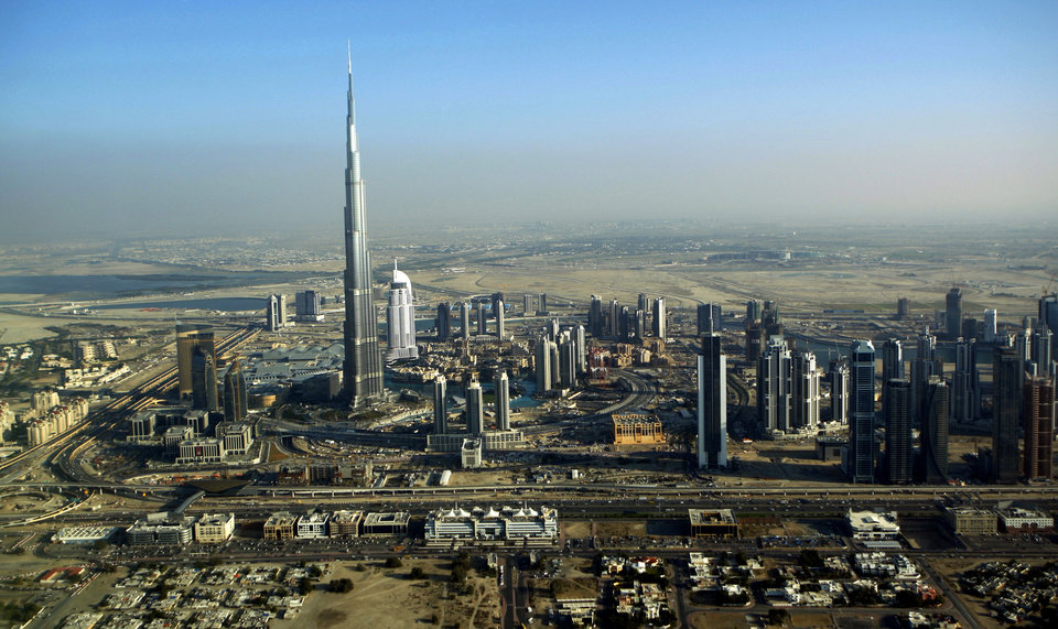 Photo -   FILE - This Sunday, Jan. 3, 2010 file photo shows the Burj Dubai, the world's tallest building, in Dubai, United Arab Emirates. It suddenly seems like Dubai is rediscovering its old habits. That means breathless hype is now back in vogue. Construction plans are again peppered with superlatives. (AP Photo/Kamran Jebreili, File)