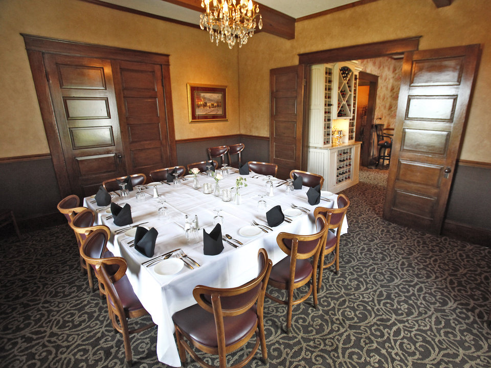 Photo -  One of the dining rooms at Twelve Oaks Restaurant. Photo by David McDaniel, The Oklahoman   David McDaniel -  The Oklahoman