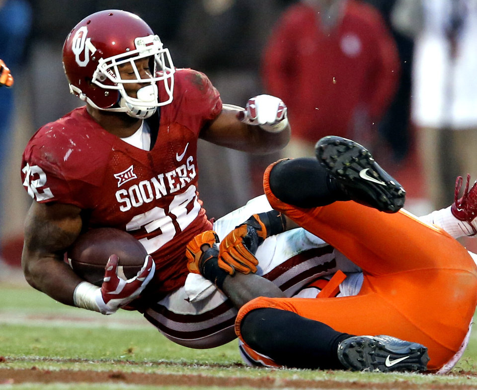 Photo - Sooner's Samaje Perine (32) carries during the second half of a Bedlam college football game between the University of Oklahoma Sooners (OU) and the Oklahoma State Cowboys (OSU) at Gaylord Family-Oklahoma Memorial Stadium in Norman, Okla., on Saturday, Dec. 6, 2014. Photo by Steve Sisney, The Oklahoman