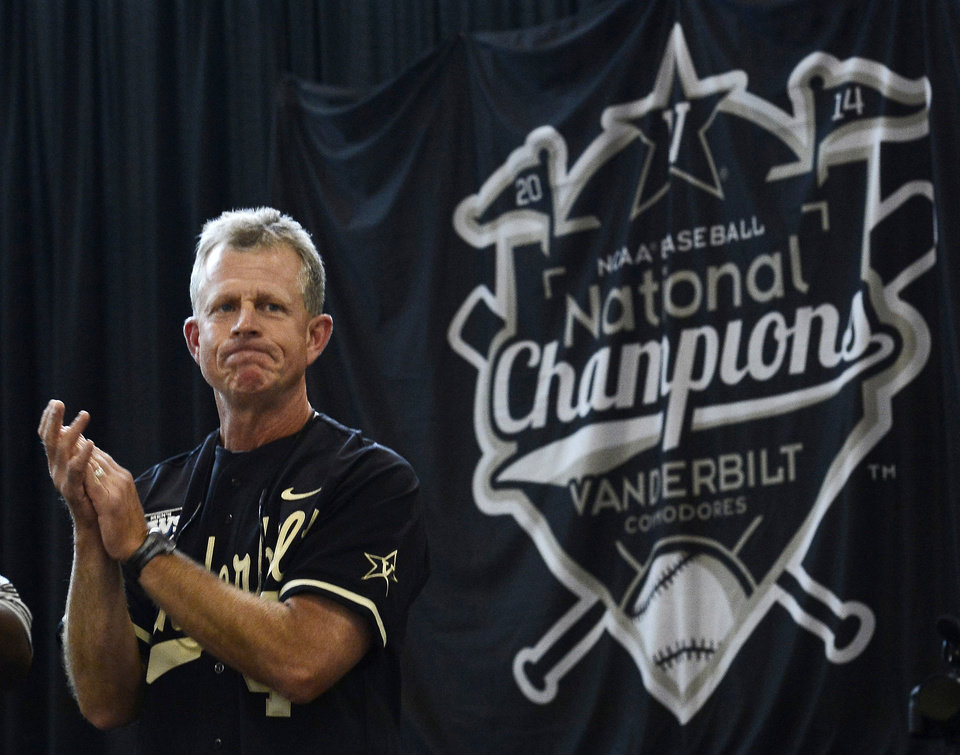 Photo - Vanderbilt head coach Tim Corbin claps as his team is introduced during the victory celebration for the team's first baseball NCAA College World Series national championship at Vanderbilt University on Thursday, June 26, 2014, in Nashville, Tenn.  (AP Photo/Mark Zaleski)