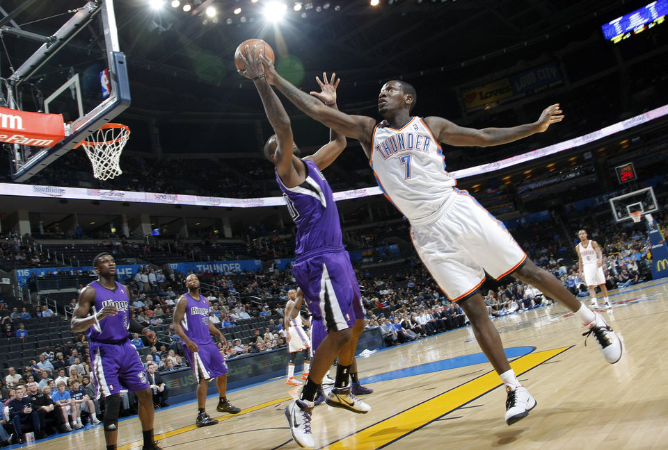 The Thunder's Royal Ivey (7) battles for a rebound with the Kings' Donte Greene (20) during the NBA basketball game between the Oklahoma City Thunder and The Sacramento Kings on Tuesday, Feb. 15, 2011, Oklahoma City Okla.  Photo by Chris Landsberger, The Oklahoman