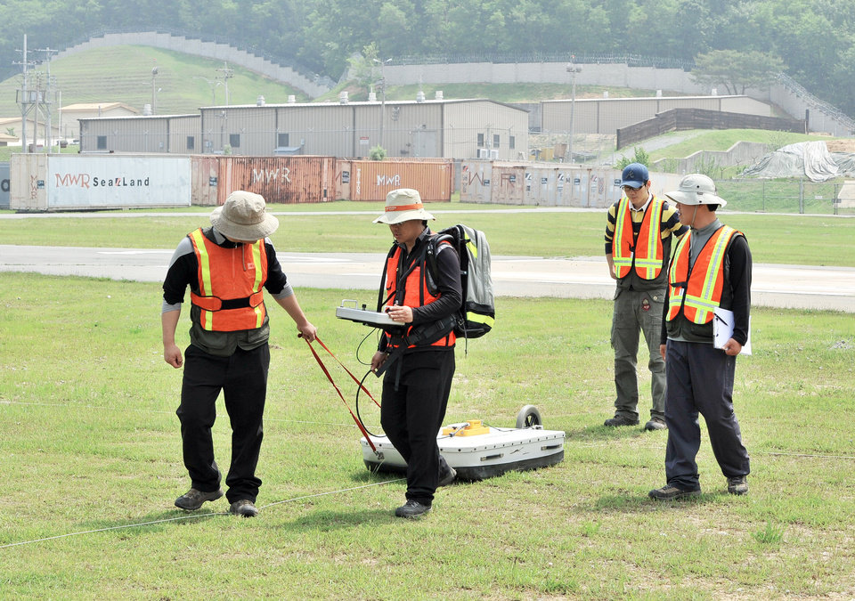 Above: South Korean technicians conduct a ground-penetrating radar survey of the alleged burial of a highly toxic defoliant at Camp Carroll.