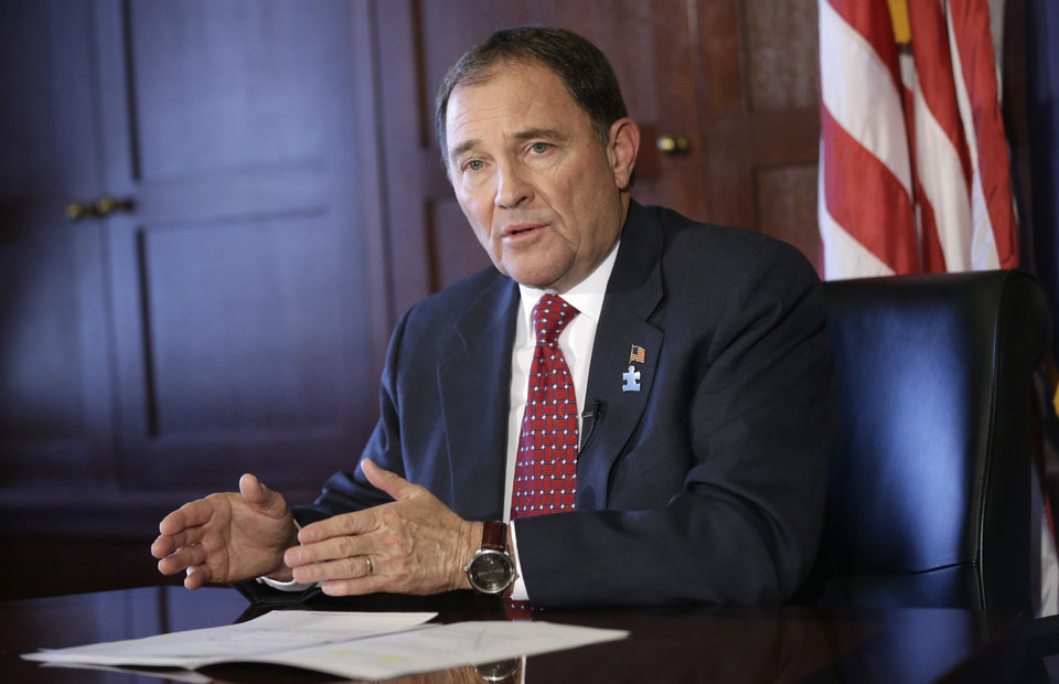 Photo - Utah Gov. Gary Herbert speaks to reporters during a news conference, Wednesday, April 2, 2014, at the Utah State Capitol, in Salt Lake City. Herbert has vetoed a bill that would boost the Legislature's subpoena power and was spurred by lawmakers' investigation of former Attorney General John Swallow. Herbert said at a news conference Wednesday afternoon that he was concerned about possible civil rights violations with the bill, which created criminal penalties for people who fail to comply with subpoenas issued by the Legislature. (AP Photo/Rick Bowmer)