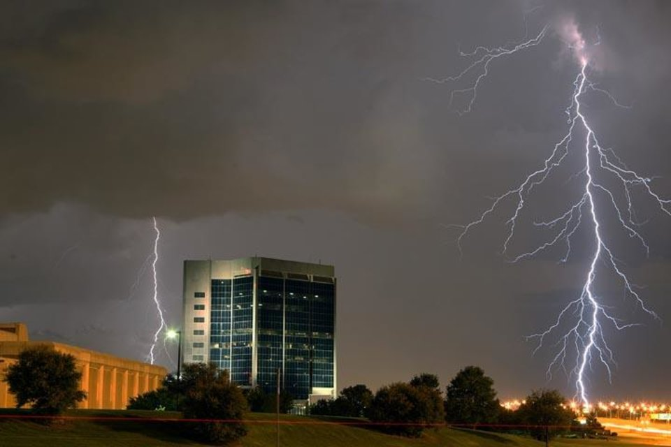 Photo -  Lightning strikes over the OPUBCO Communications building late Wednesday, Aug. 5, 2009, night as storms rolled across central Oklahoma. Photo by Hugh Scott, The Oklahoman.