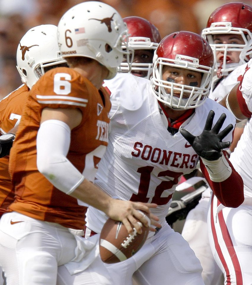 Oklahoma's Travis Lewis puts pressure on Texas' Case McCoy (6) during the Red River Rivalry college football game between the University of Oklahoma Sooners (OU) and the University of Texas Longhorns (UT) at the Cotton Bowl in Dallas, Saturday, Oct. 8, 2011. Oklahoma won 55-17. Photo by Bryan Terry, The Oklahoman