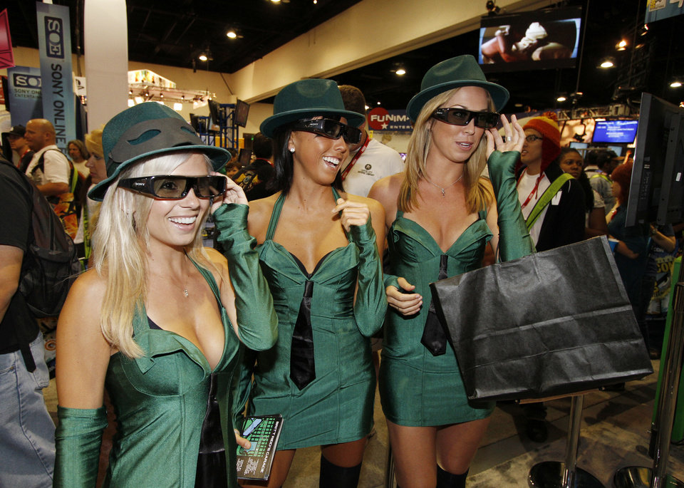 Models promoting the movie Green Hornet wear 3D glasses at the Sony Entertainment booth at the preview night for  Comic-Con International Wednesday, July 21, 2010 in San Diego.  (AP Photo/Denis Poroy)