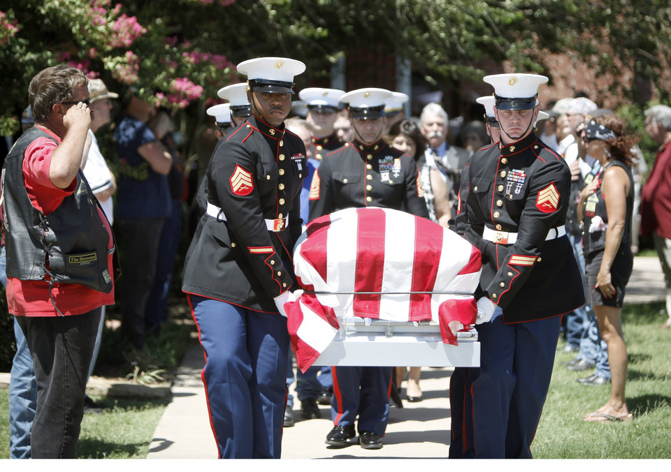 A honor guard carries the casket of Marine Lance Cpl. Jonathan Stroud of Cashion, Okla., at the Heritage Baptist Church, Saturday, Aug. 8, 2009, in Oklahoma City . Photo by Sarah Phipps,The Oklahoman