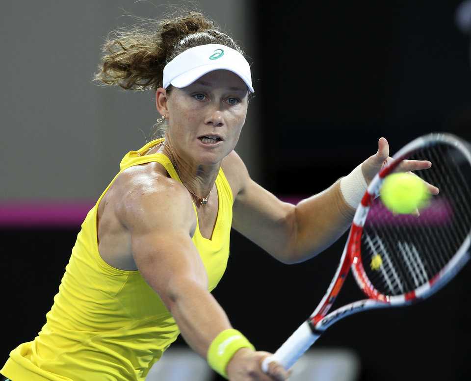 Photo - Samantha Stosur of Australia plays a shot in her match against Angelique Kerber of Germany during the Fed Cup semifinals between Australia and Germany in Brisbane, Australia, Sunday, April 20, 2014. (AP Photo/Tertius Pickard)