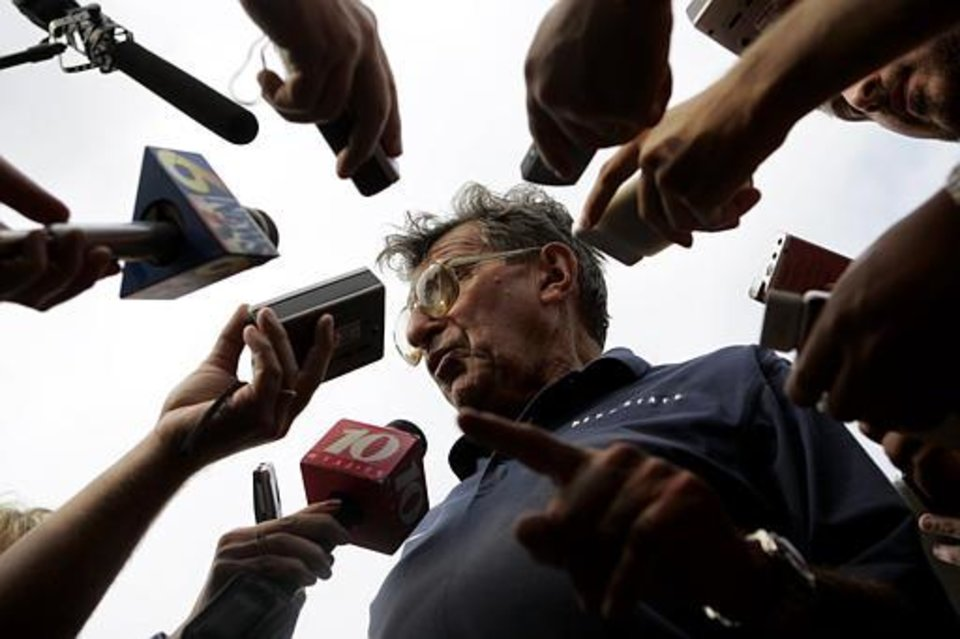 Photo - Penn State football coach Joe Paterno talks to reporters after practice in State College, Pa., Friday Aug. 26, 2005. (AP Photo/Caolyn Kaster)