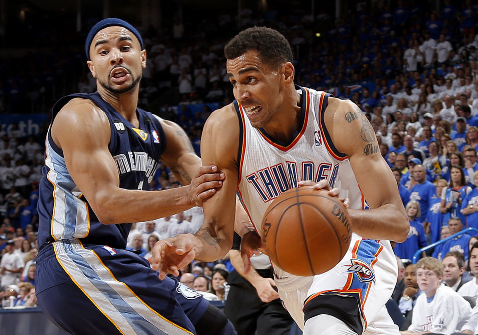 Oklahoma City\'s Thabo Sefolosha (2) goes past Memphis\' Jerryd Bayless (7) during Game 2 in the second round of the NBA playoffs between the Oklahoma City Thunder and the Memphis Grizzlies at Chesapeake Energy Arena in Oklahoma City, Tuesday, May 7, 2013. Photo by Bryan Terry, The Oklahoman