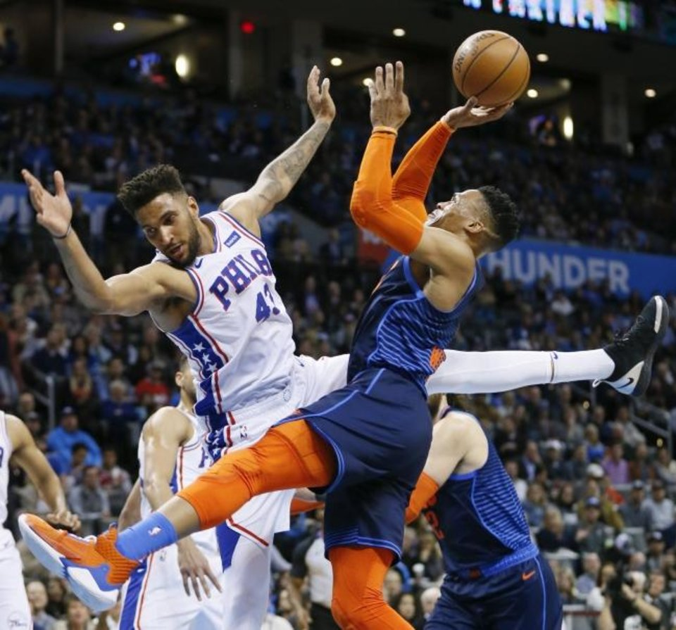 Photo -  Russell Westbrook drives against Philadelphia's Jonah Bolden last February. [Nate Billings/The Oklahoman]