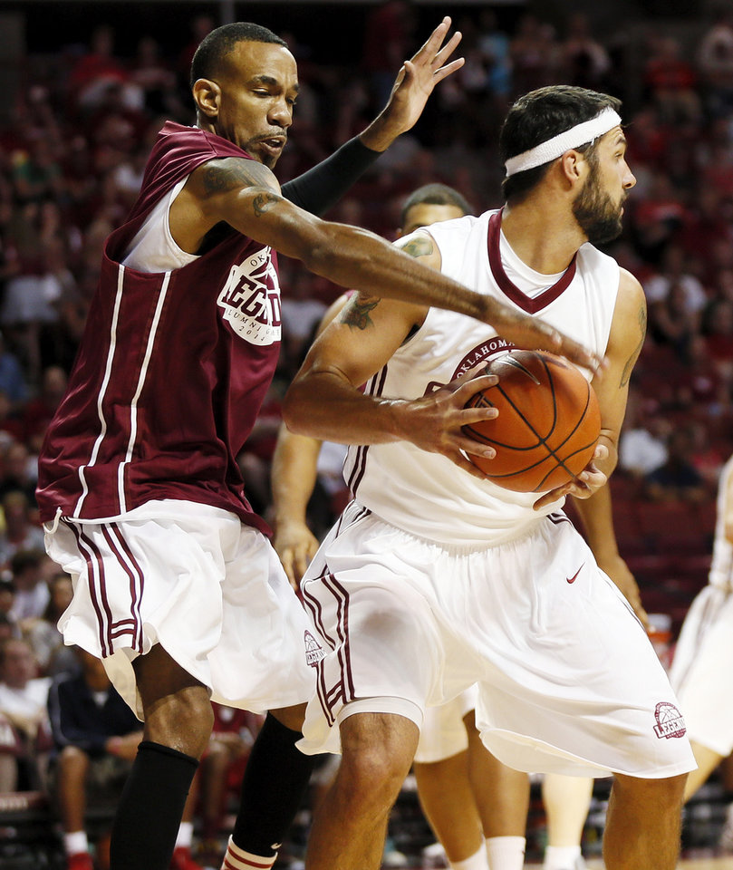Photo - Kermit Holmes tries to steal the ball from Beau Gerber during the OU Legends Alumni Game in Lloyd Noble Center in Norman, Okla., Saturday, Aug. 23, 2014. The game is part of the Sooner Basketball Family Weekend. Photo by Nate Billings, The Oklahoman