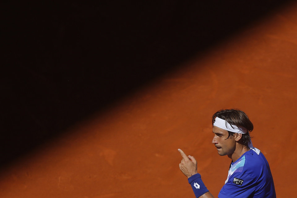 Photo - David Ferrer from Spain gestures during a Madrid Open tennis tournament match against Albert Ramos from Spain, in Madrid, Spain, Tuesday, May 6, 2014. (AP Photo/Andres Kudacki)