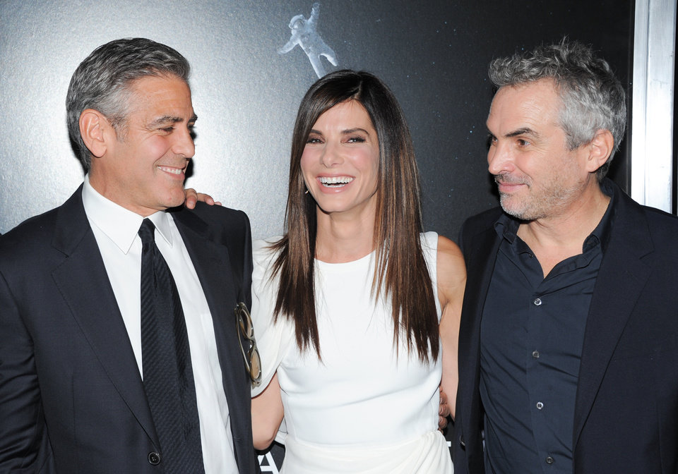 "Photo - Actor George Clooney, left, actress Sandra Bullock and director Alfonso Cuaron pose together at the premiere of ""Gravity"" at the AMC Lincoln Square Theaters on Tuesday, Oct. 1, 2013, in New York. (Photo by Evan Agostini/Invision/AP) ORG XMIT: NYEA127"