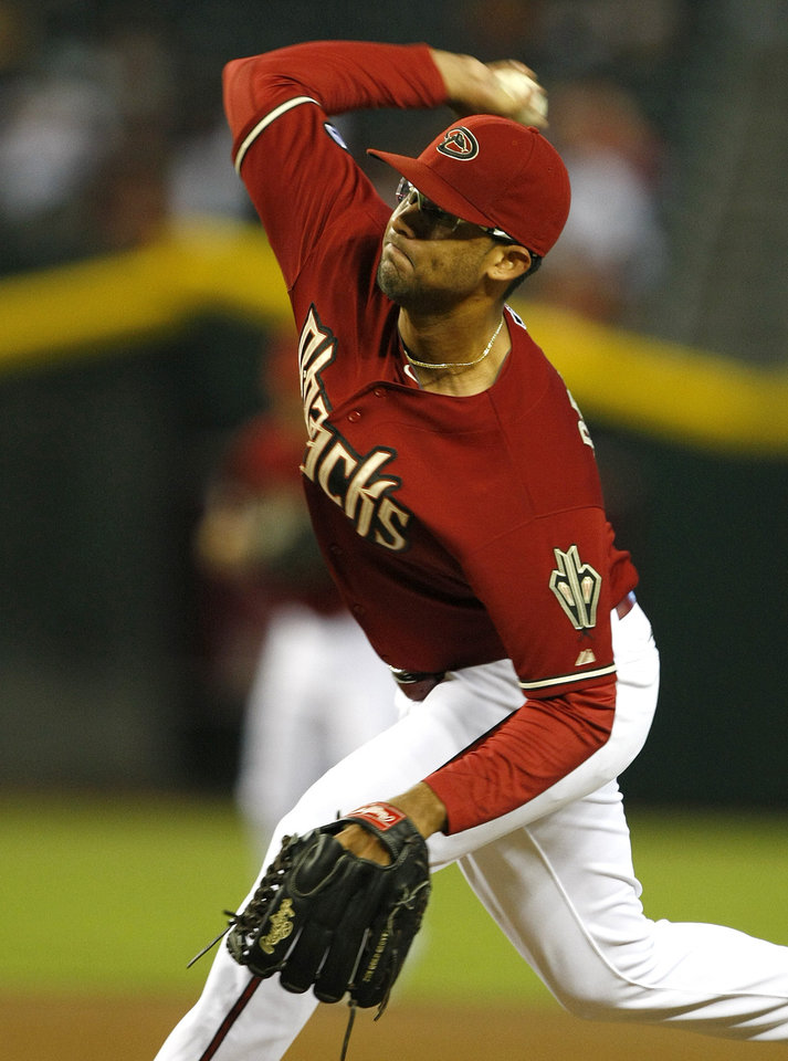 Photo - Arizona Diamondbacks starting pitcher Randall Delgado throws in the first inning during a baseball game against the Colorado Rockies, Sunday, Sept. 15, 2013, in Phoenix. (AP Photo/Rick Scuteri)