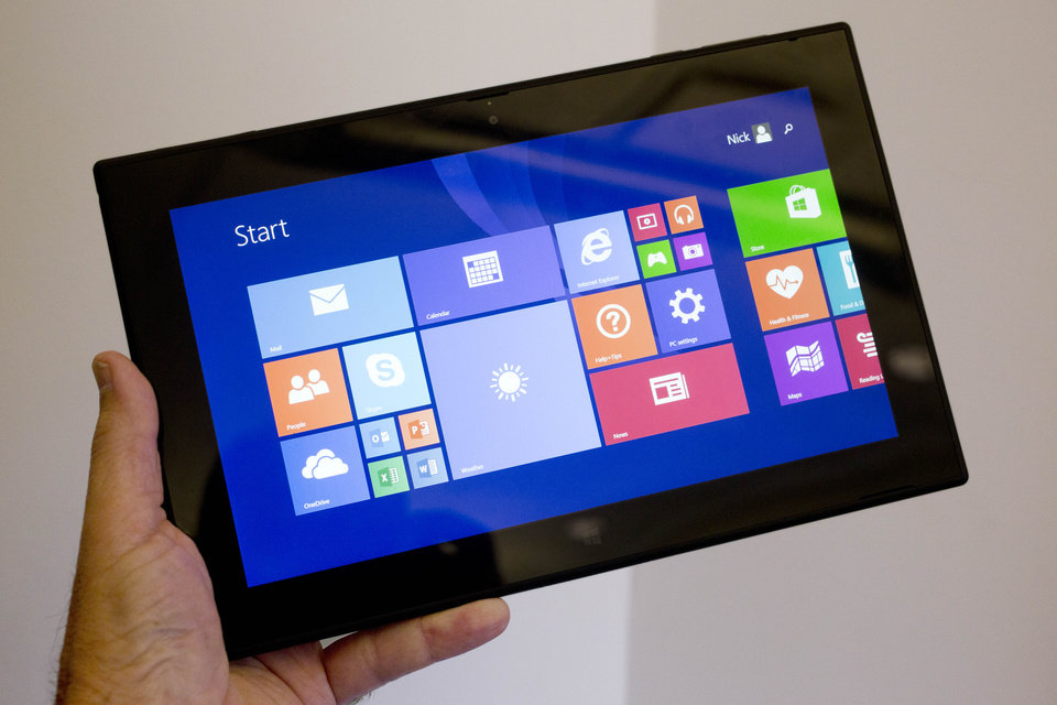 Photo - This Friday, June 20, 2014 photo shows the Lumia 2520 tablet and keyboard, in New York. The tablet starts at about $600 and the optional keyboard cover is another $150. (AP Photo/Mark Lennihan)