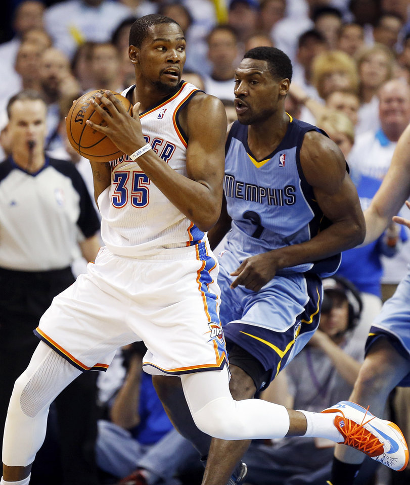 Photo - Oklahoma City's Kevin Durant (35) works against Memphis' Tony Allen (9) during Game 2 in the first round of the NBA playoffs between the Oklahoma City Thunder and the Memphis Grizzlies at Chesapeake Energy Arena in Oklahoma City, Monday, April 21, 2014. Memphis won 111-105 in overtime. Photo by Nate Billings, The Oklahoman