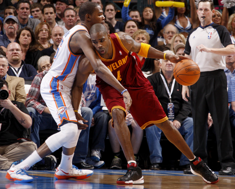 Oklahoma City\'s Kevin Durant (35) defends Cleveland\'s Antawn Jamison (4) during the NBA basketball game between the Oklahoma City Thunder and the Cleveland Cavaliers at Chesapeake Energy Arena in Oklahoma City, Friday, March 9, 2012. Photo by Bryan Terry, The Oklahoman