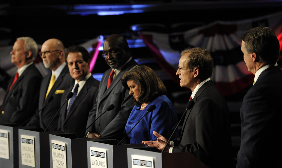 Photo - Republican Senatorial candidates, from left to right, Rep. Paul Broun of Athens, Ga., Art Gardner, a patent lawyer, Rep. Phil Gingery of Marietta, Ga., Derrick Grayson, a network engineer, former Georgia Secretary of State Karen Handel, Rep. Jack Kingston of Savannah, Ga., and former Dollar General CEO David Perdue participate in a debate at the Georgia Public Broadcasting studio, Sunday, May 11, 2014, in Atlanta. (AP Photo/David Tulis)