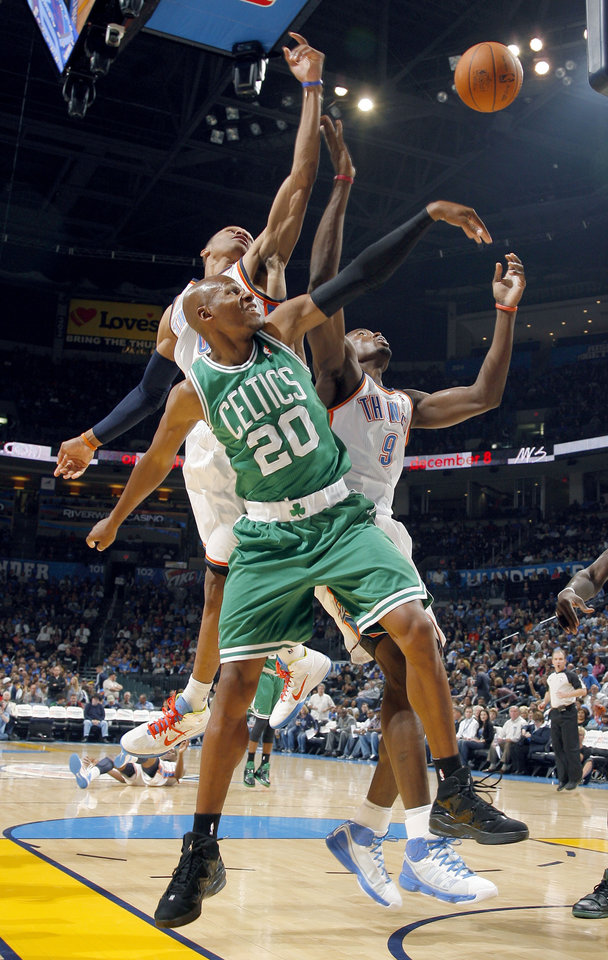 Photo - Oklahoma City's Russell Westbrook (0) and Serge Ibaka (9) fight Boston's Ray Allen for a rebound during the NBA game between the Oklahoma City Thunder and the Boston Celtics, Sunday, Nov. 7, 2010, at the Oklahoma City Arena. Photo by Sarah Phipps, The Oklahoman